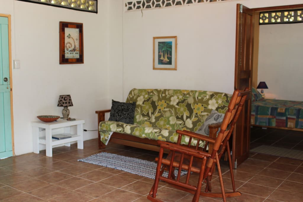 Sitting room in casita with futon, small TV