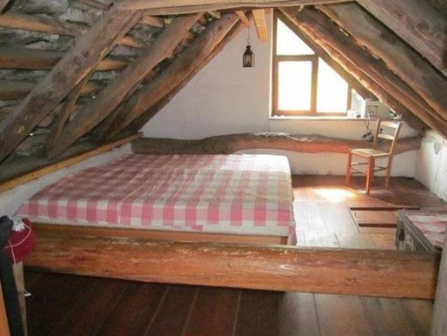 The top floor bed room. We also love sleeping on the sleeping terrace