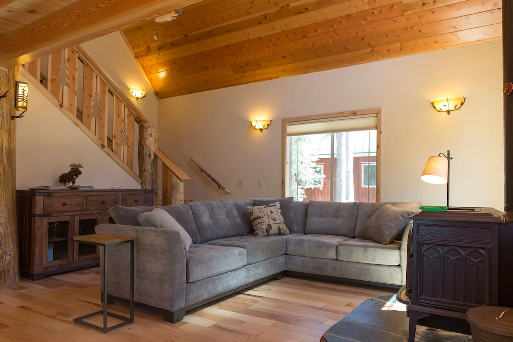 Living Room with comfy sofa and wood stove