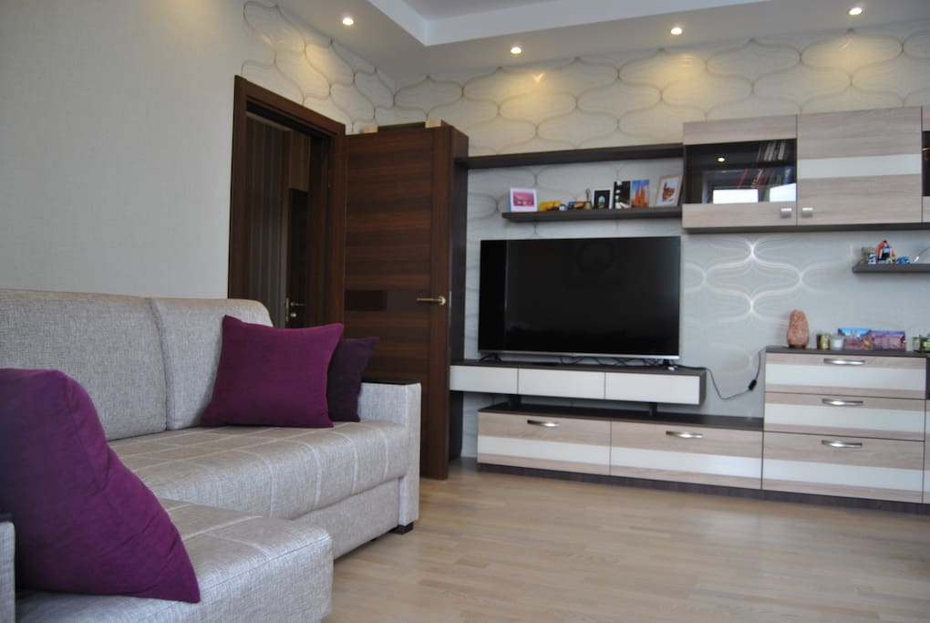 Lounge area, sofa with TV