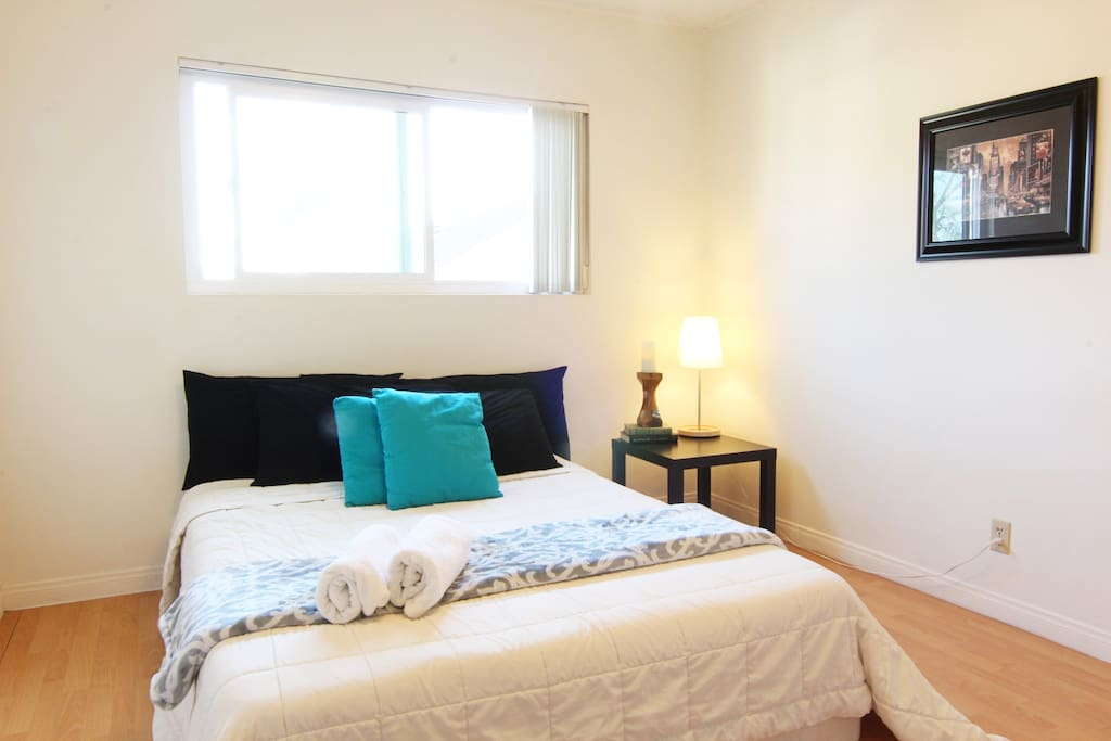 Spacious main bedroom with large super comfy tempurpedic style queen bed.