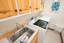 The large laundry room allows you plenty of room to wash, dry, and fold your clothes.