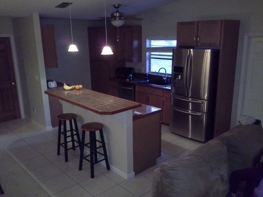 Full Kitchen all new . Breakfast Bar or conv. area all common.