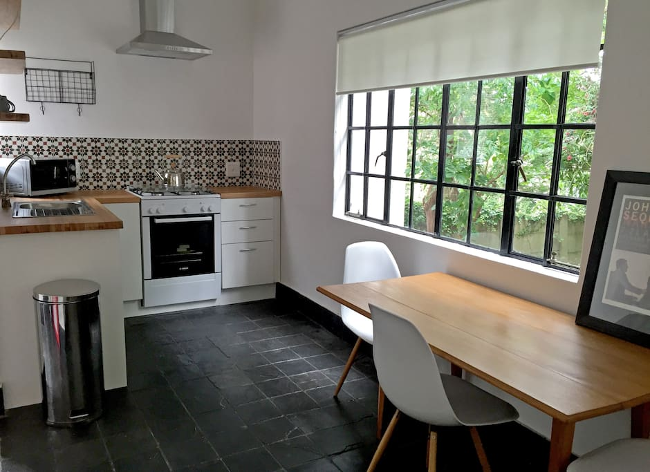 Kitchen with dining table and private garden view