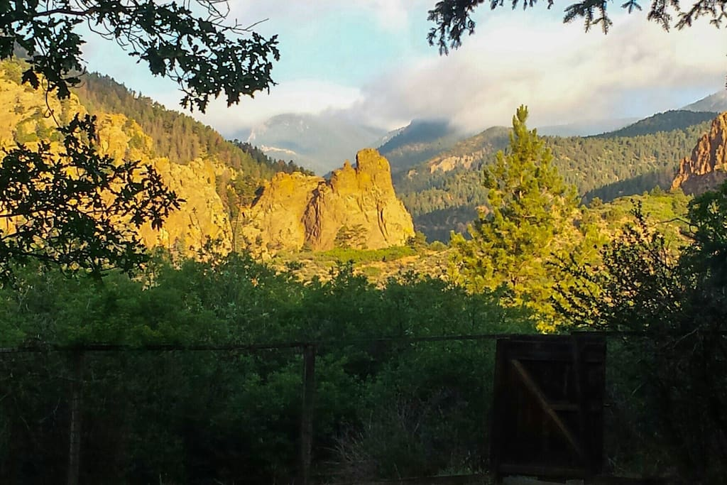 Early morning sunrise hitting the peaks in Cheyenne canyon. View from the back porch!
