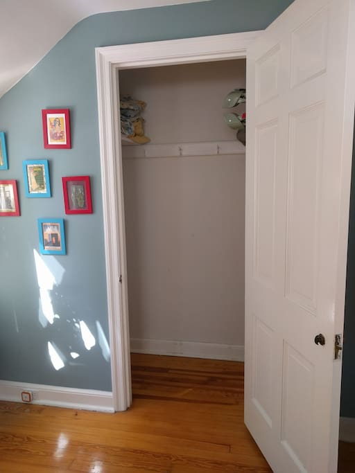 Double Bedroom closet with extra sheets and travel crib
