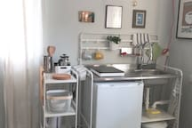 Prepare breakfast or dinner at our kitchenette with induction burner, fridge/freezer, and coffee station.