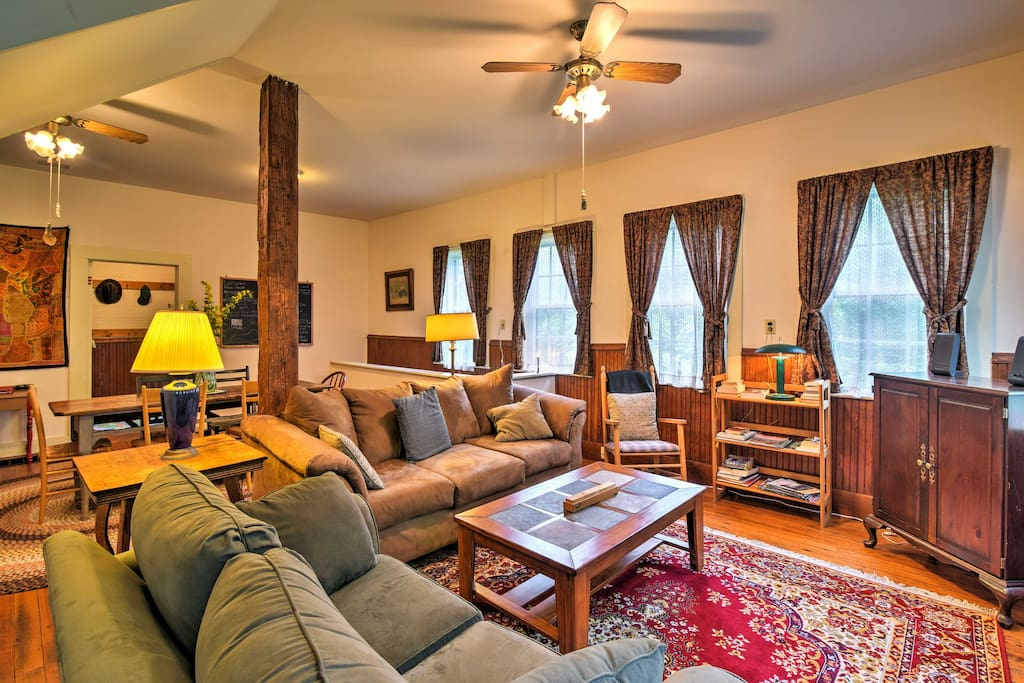 Let your stress melt away as you gather in the living room with 2 plush couches, a rocking chair, and a satellite TV.