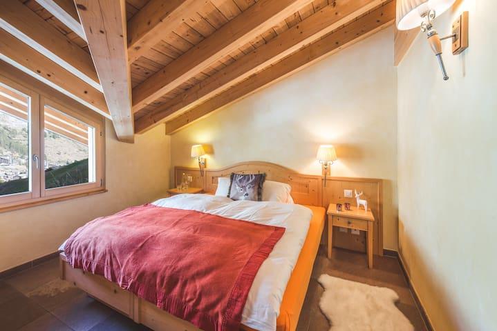 Bedroom upper floor with mountain view