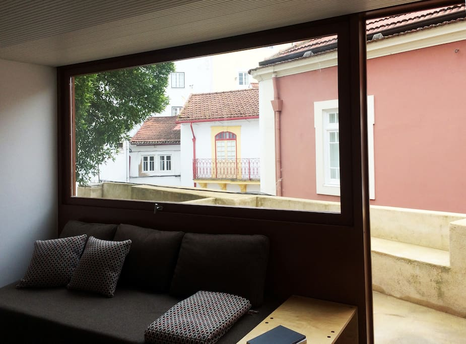 Living room and access to private patio and shared garden