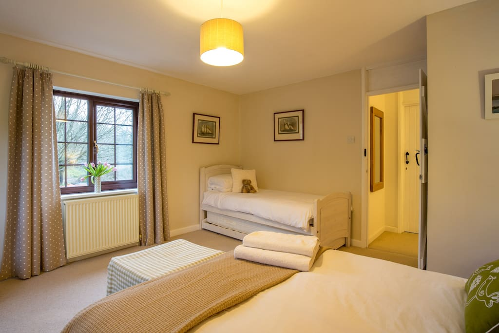This room has two additional single beds so perfect for families of 4