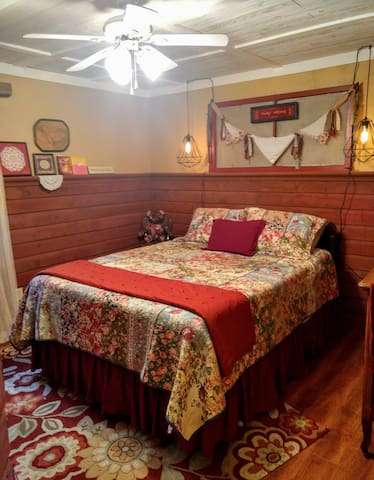 Quaint Master bedroom with queen size bed.