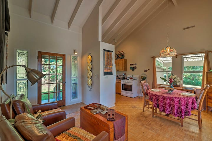 This charming abode rests on 3 verdant acres with fruit trees and flowers.