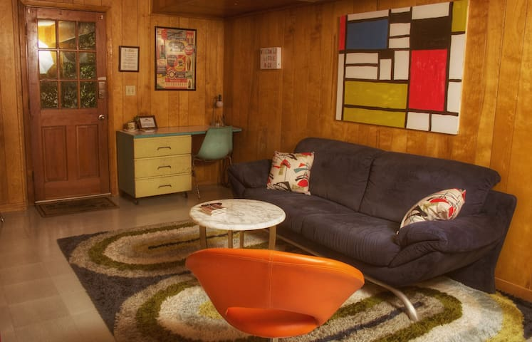 This is the living room with a desk and tv.  Guest's private entrance enters here. This is a panoramic photo you can click on to get a better sense of the layout.