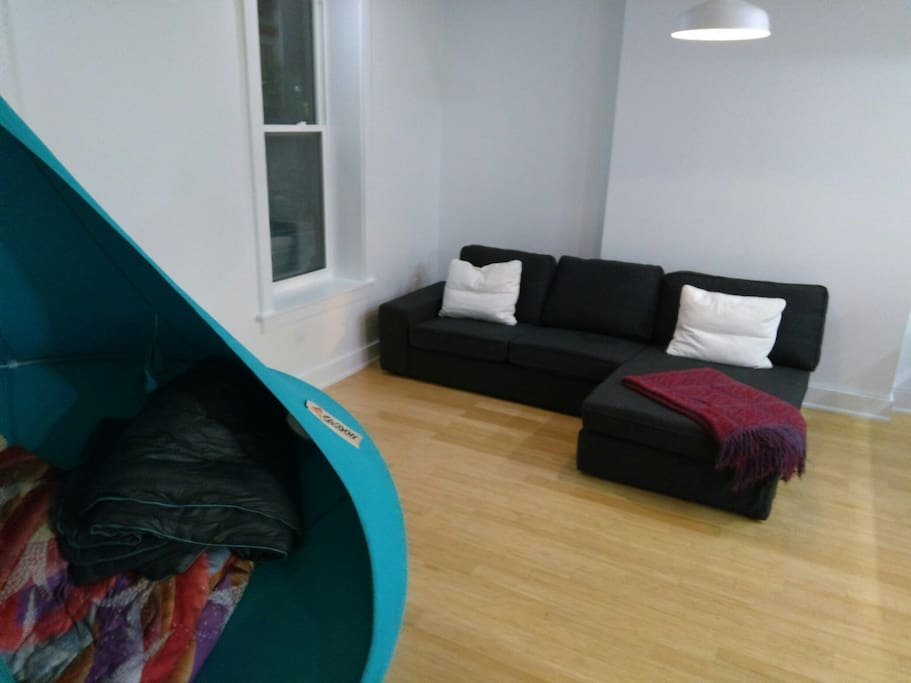 chill in the suspended pod or the sectional sofa. kensington market is right outside the window