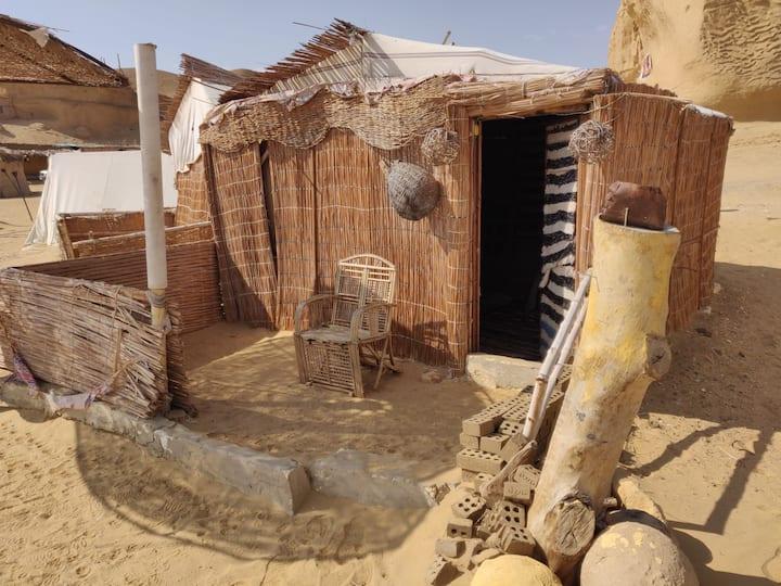 Beautiful hut on desert plateau overlooking lake