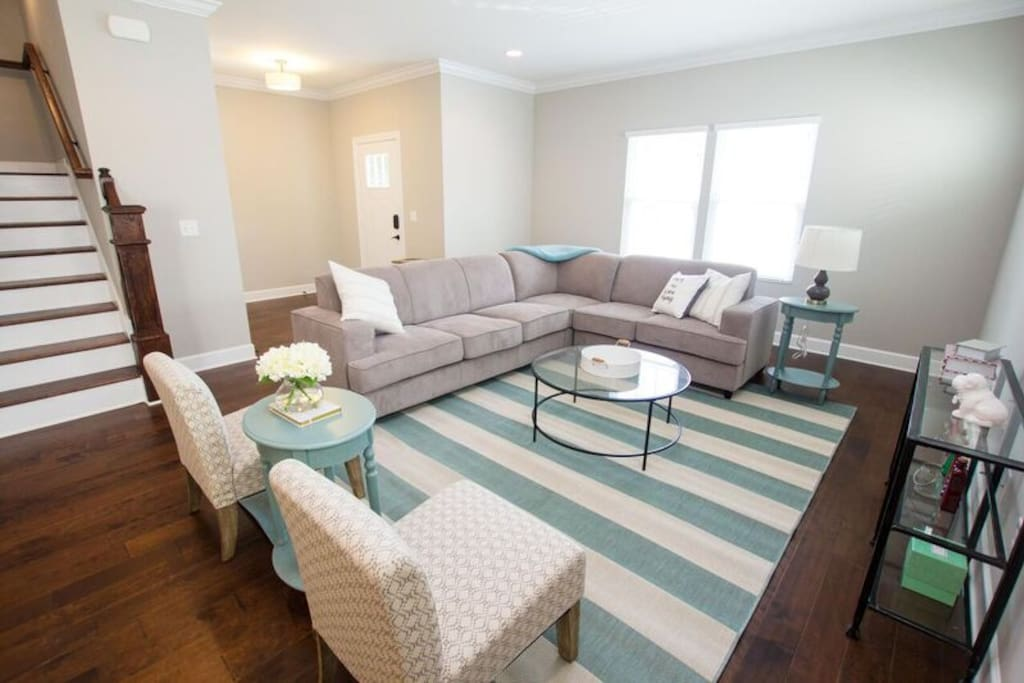 Our colorful living room features a sofa bed for extra space!