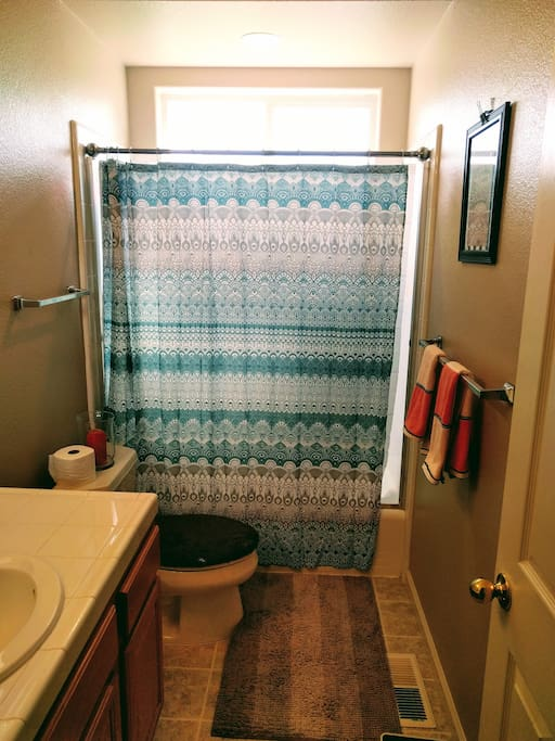 Shared bathroom with privacy lock on door. Shared with one other room. Max. two guests.