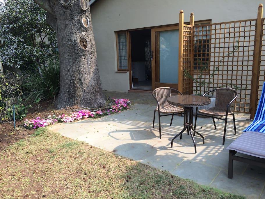 Patio facing the garden - access from sliding door