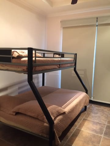 Third room with one twin bed on top and with one full bed down