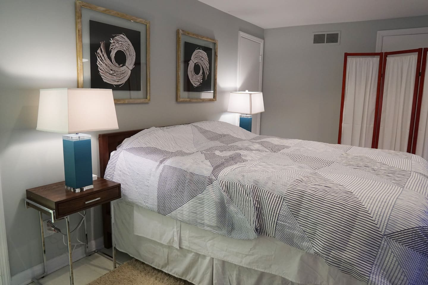 The bedroom features a comfy queen size mattress and convenient usb access on both night stands.