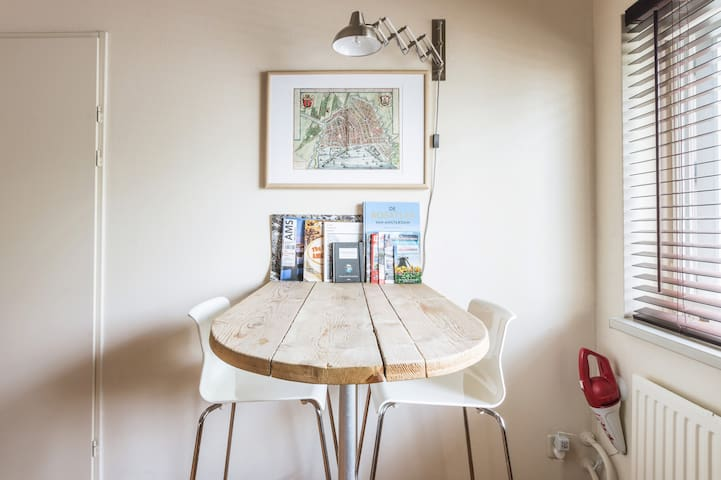 Reading table with a selection of maps and magazines.