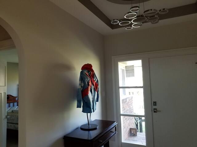 Foyer with antique jockey silks displayed