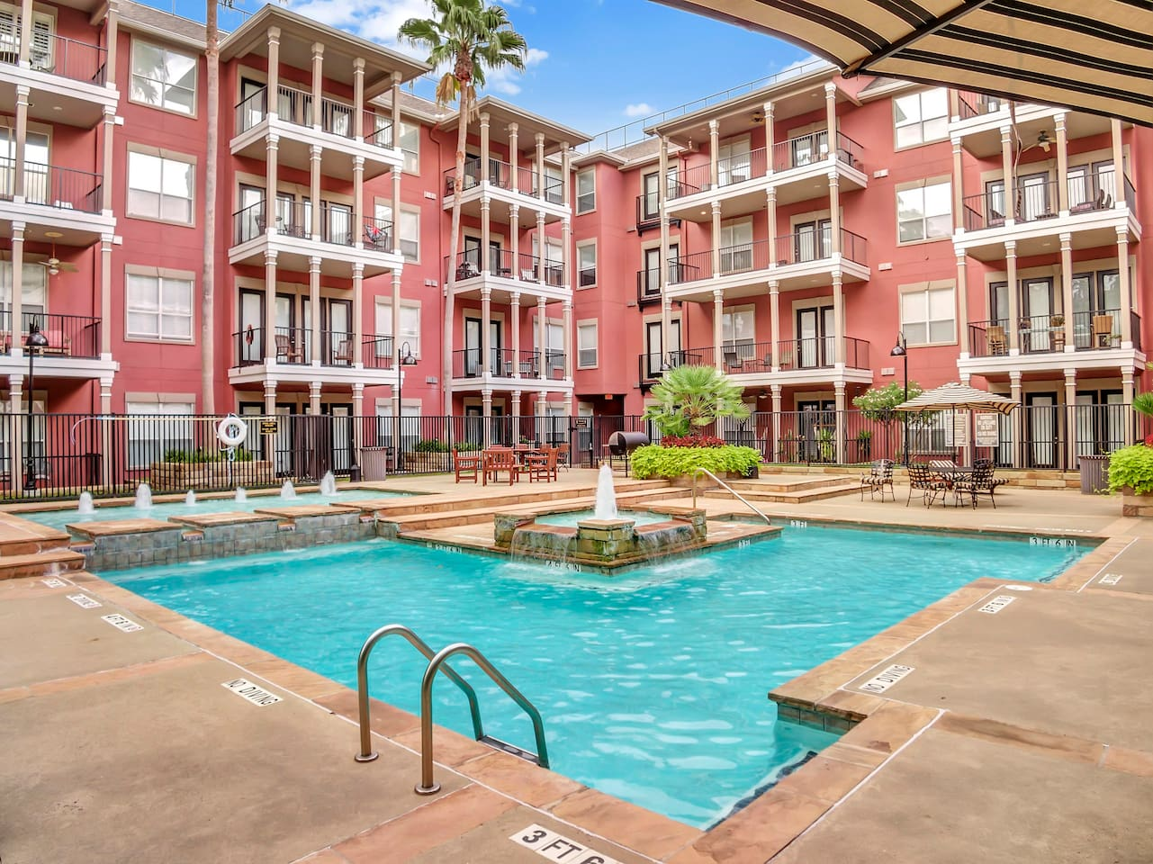 Enjoy resort-style pool, tanning pool, gas grills, lounge seating, peace and quiet at 2400 McCue!