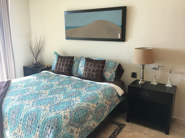 Second bedroom with king size bed, access to main terrace and with private bathroom