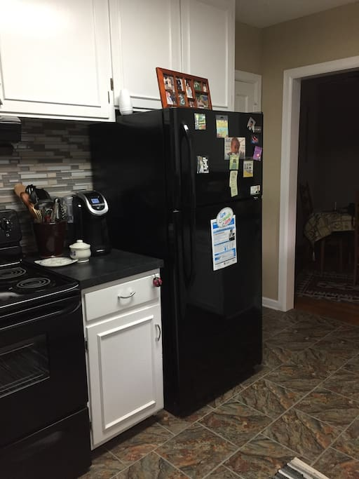 The kitchen features modern appliances that guests may use.