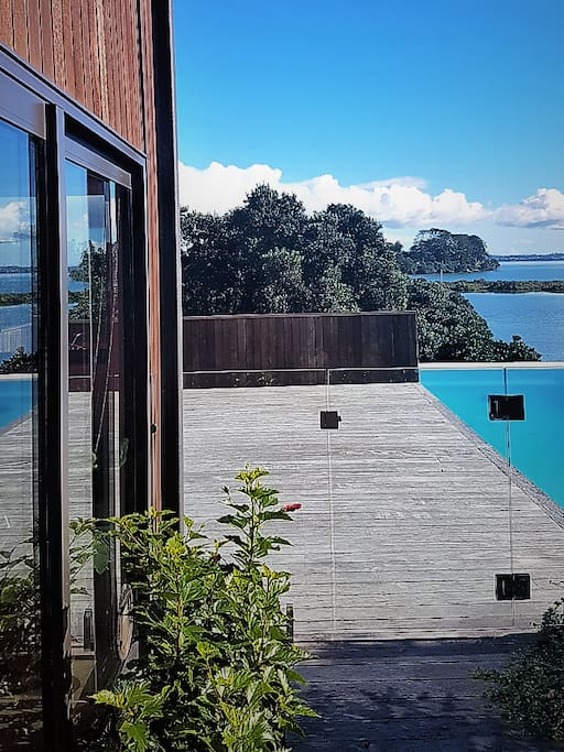 house, pool and sea beyond