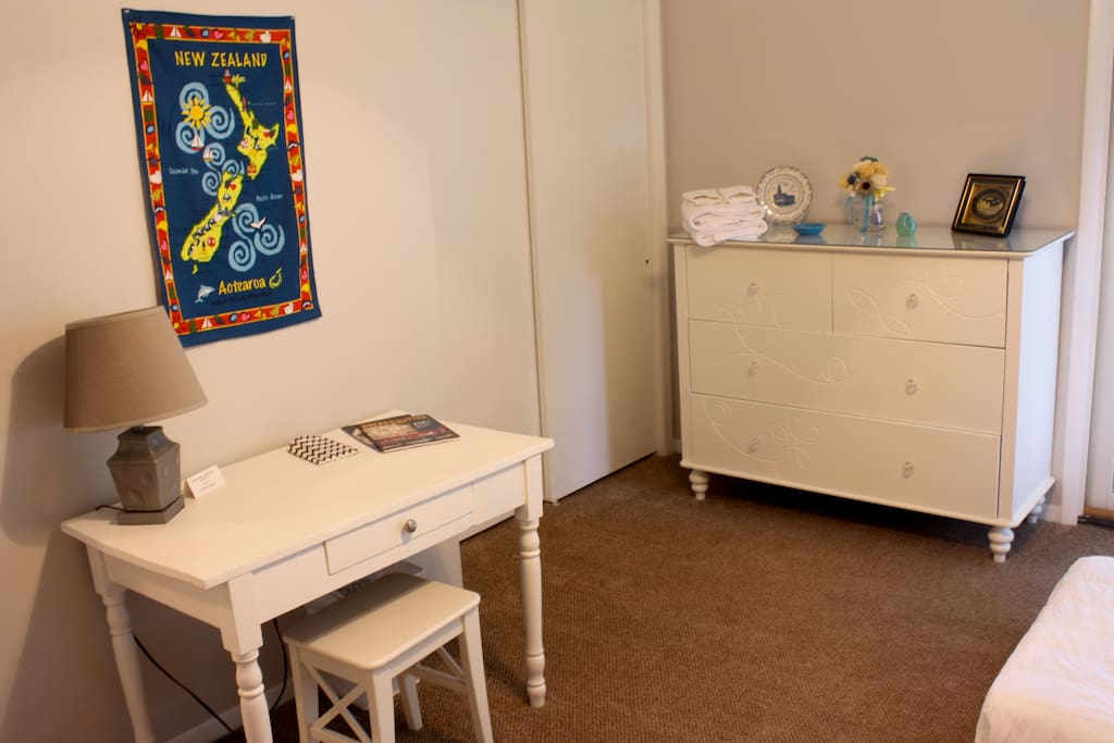A desk and an empty dresser are available for you to store your things during your stay.