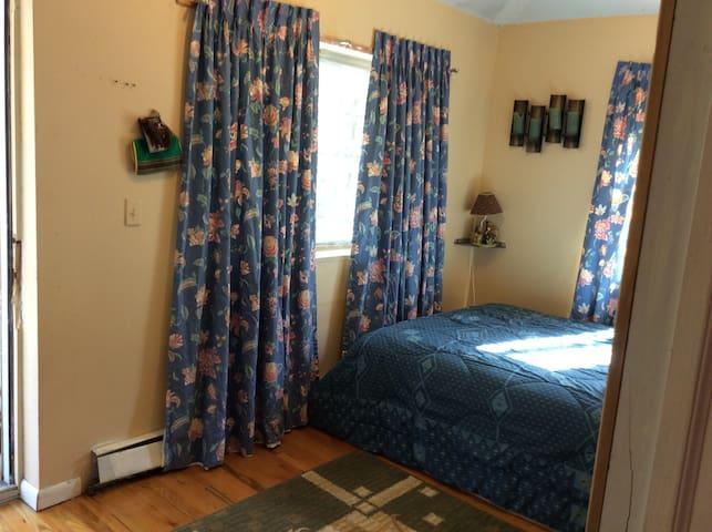 Sunny bedroom with balcony, Queens