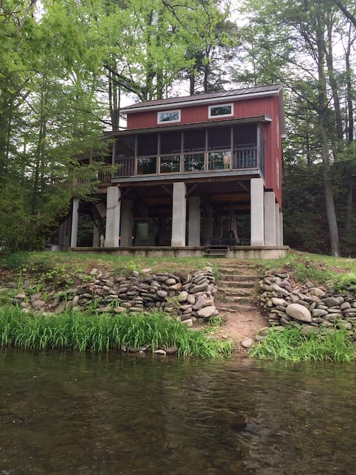 Screen porch with tempered glass gives a perfect creek view.