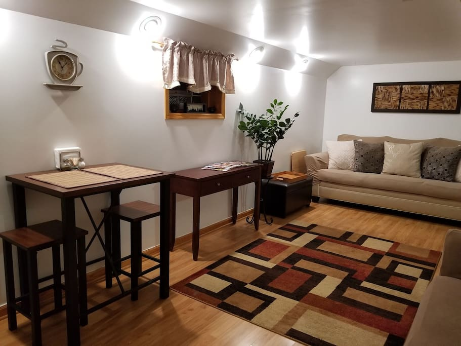 Living room space featuring a new small dining table for 2