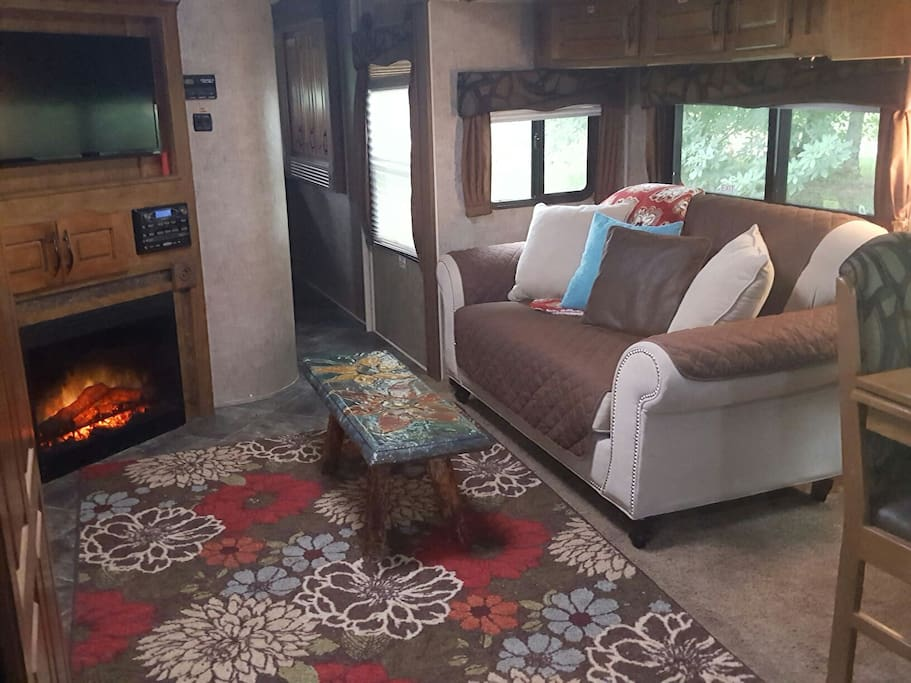 living room with upgraded love seat, fireplace, and tv