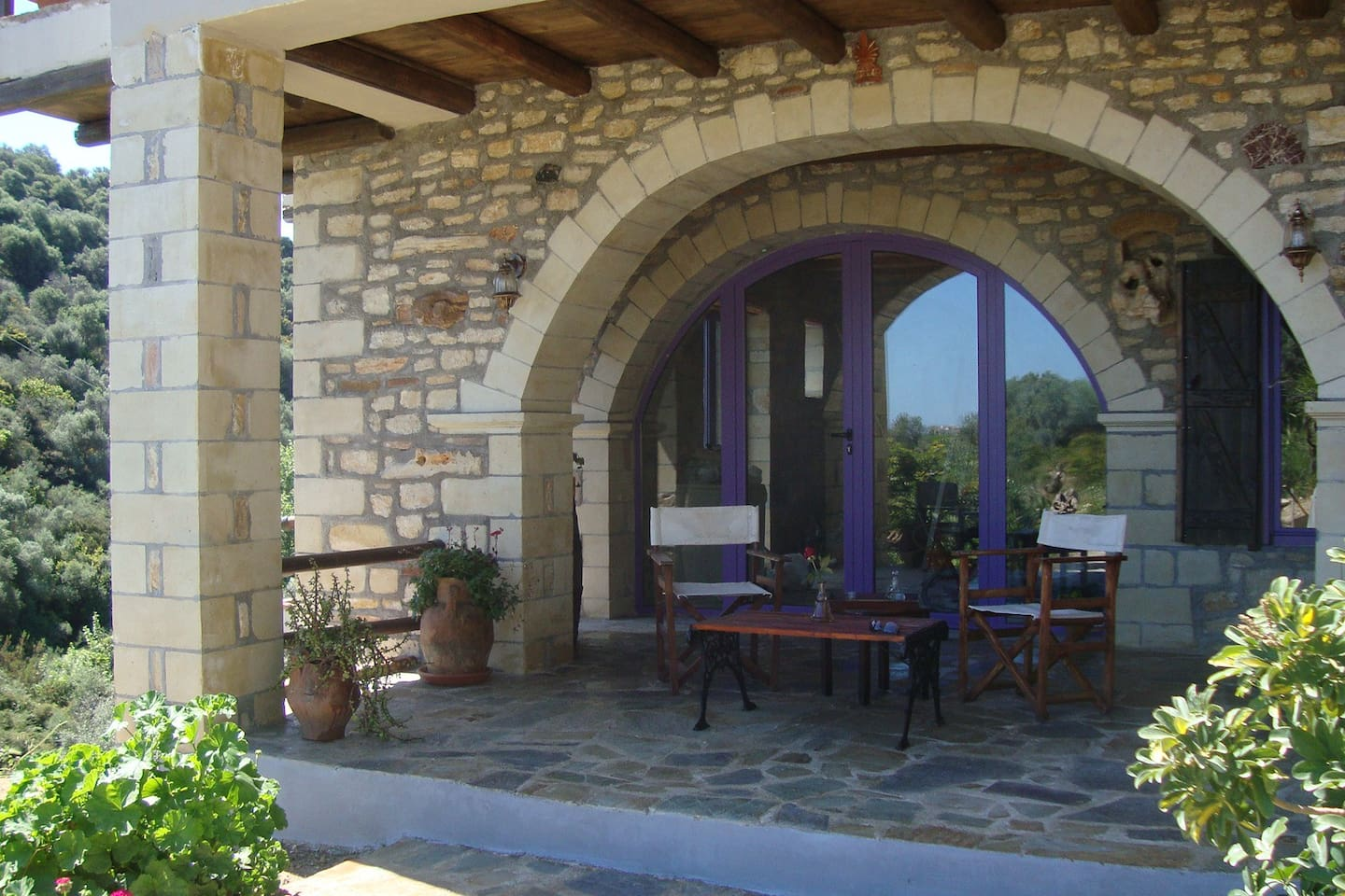 Enter from the gravel court, pass by the pool and make your way through the stone arch in the veranda...