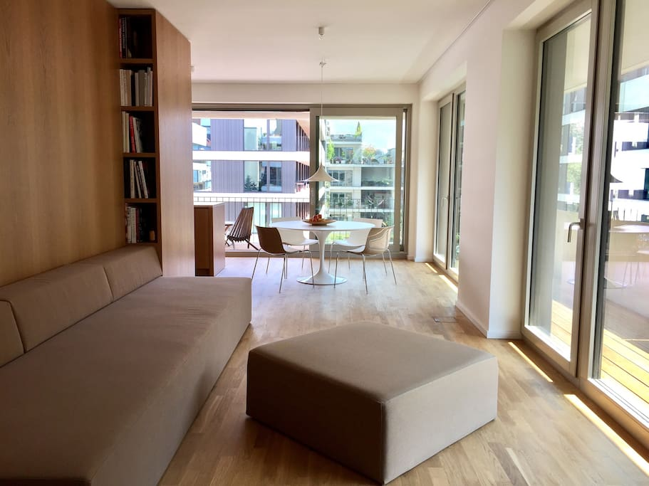 sunny living and eating area with two floor to ceiling windowfronts which open to a 30qm terrasse
