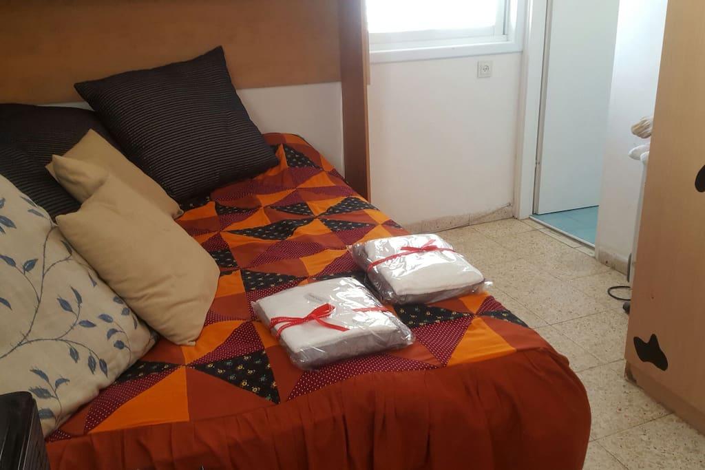 A queen bed in your room.