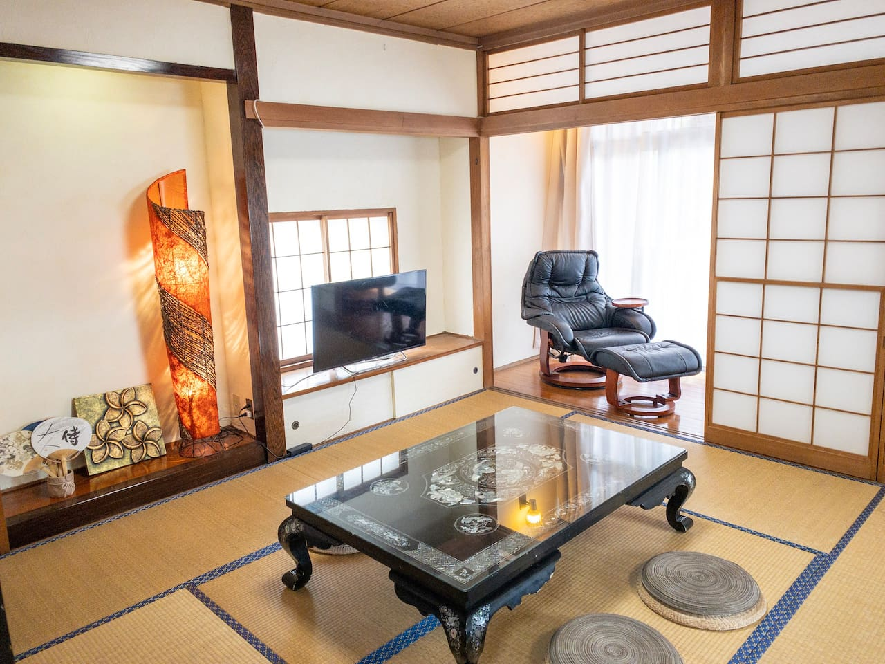 Spacious Japanese Tatami room used as living room with 'Engawa' which is facing the balcony. You can enjoy television (Netflix) here.