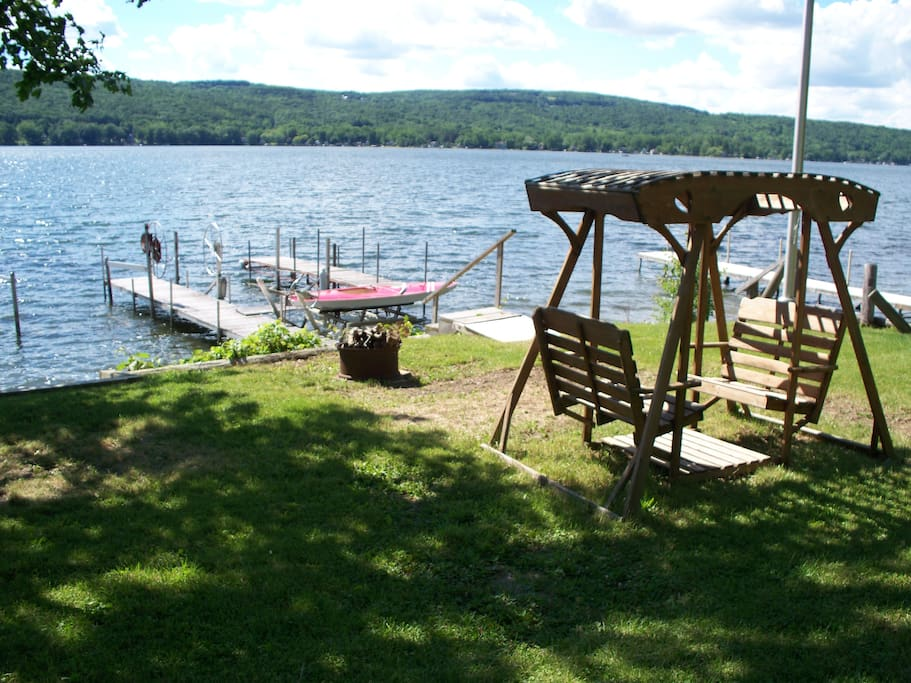 lakefront with dock, hoist and swing