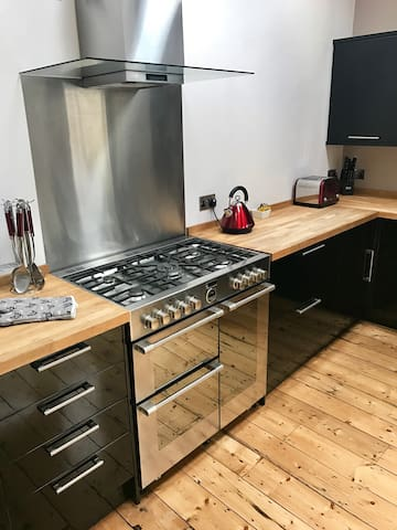 Fully equipped kitchen leading onto garden