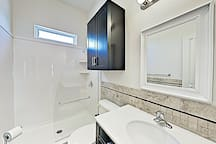 The guest bathroom is configured with a walk-in shower.