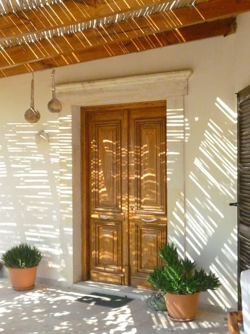 The main wooden door to the house, inside the courtyard, designed by my mother, Sophia.