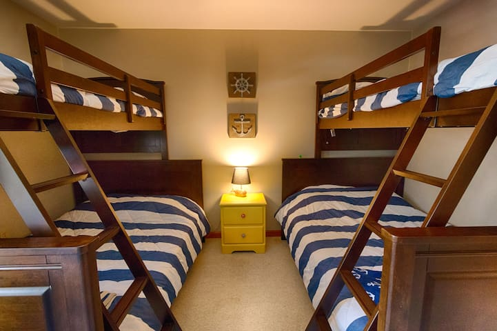 The bunkroom! Two bunkbeds with twins over full.