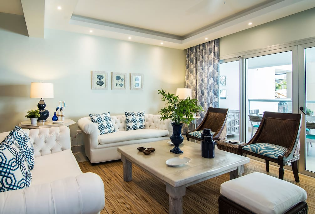 The Spacious Livingroom comes with a lounge area, TV + Cable, AC, WIFI and Fully Equipped open Kitchen