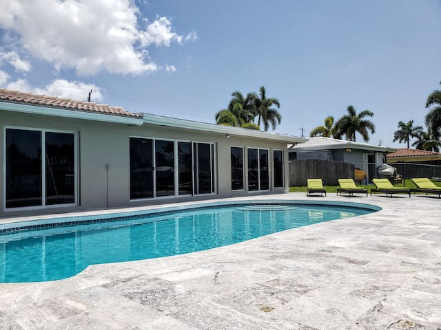 Upscale mid century canal front retreat w/pool