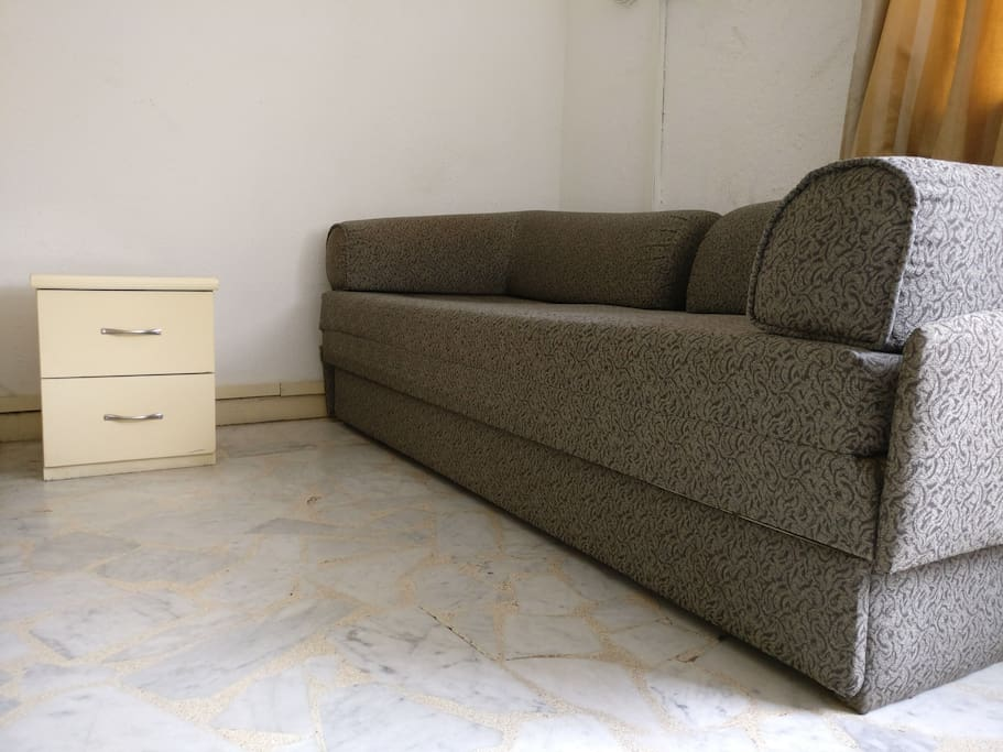 A sofa cum bed for the third guest