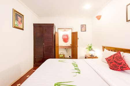 Deluxe Double King size bed with Garden View equipped with amenities.