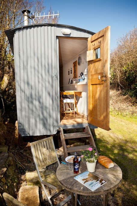 Steps up to the Hut, with folding table and two chairs